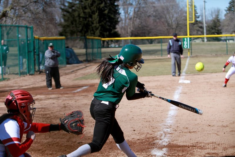 Abby Davidson hits the ball in the Eagles 9-7 loss to Miami (OH) in Ypsilanti on Saturday,