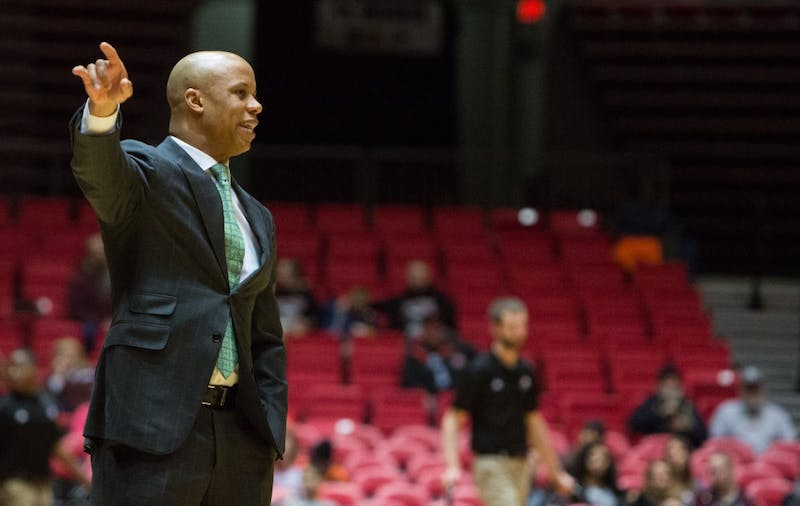 Eastern Michigan head coach Rob Murphy calls out the play in the Eagles 61-59 double overtime loss to Northern Illinois Thursday in Dekalb.