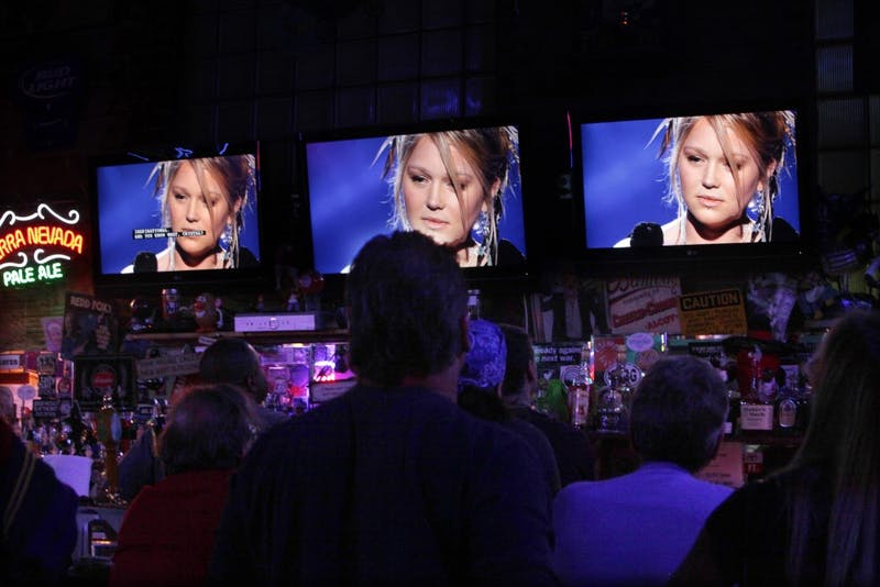 """""""American Idol"""" contender Crystal Bowersox, seen on several TV screens while performing on the Fox show, in The Village Idiot in Maumee, Ohio. Bowersox played in the bar regularly before she won a spot on """"American Idol."""" (Nancy Stone/Chicago Tribune/MCT)"""
