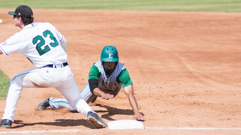 Marquise Gill slides to first versus Ohio on Saturday, April 26.