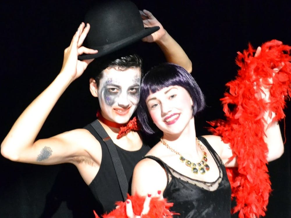 "Parker Stephen Nolan as ""Emcee"" and Rosemary Coryell as ""Sally Bowles"". Photo courtesy of EMU Theatre."