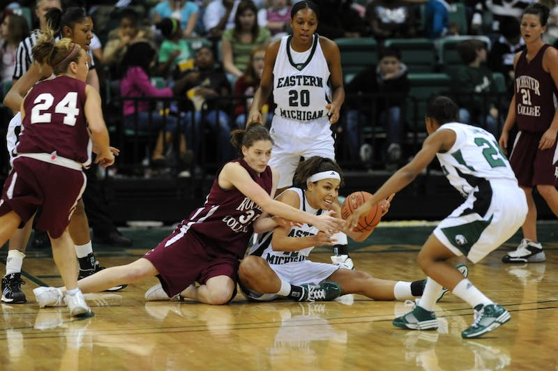 Eastern Michigan and Rochester College players wrestle for the ball Wednesday.