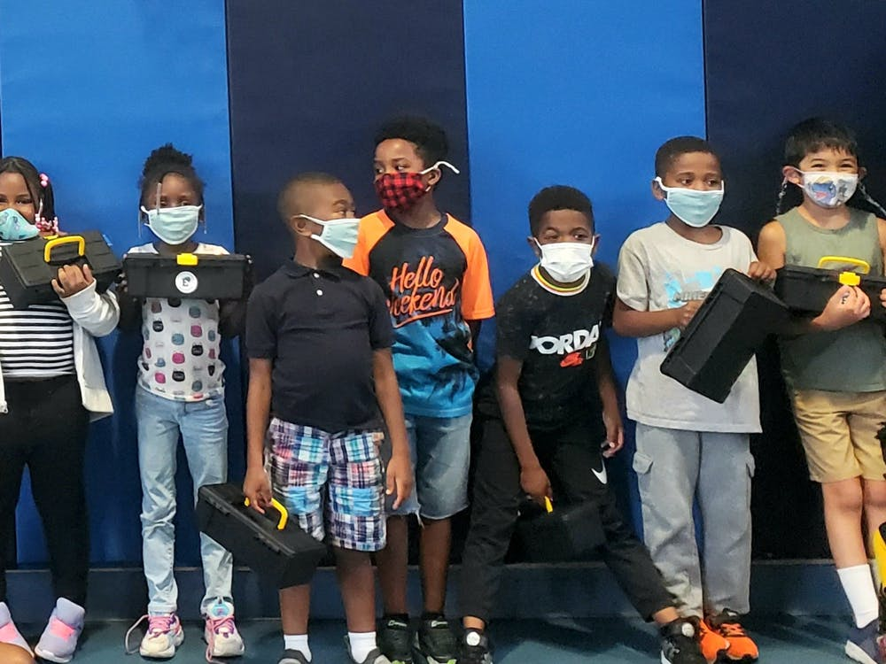 Kids involved in the program with the STEM kits. (Photo courtesy of Ypsilanti District Libraries)