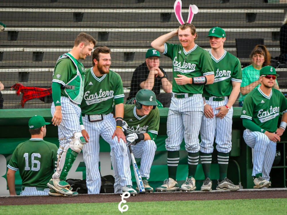 Baseball players stay loose in dugout on April 21 at Oestrike Stadium. @EMU_Baseball