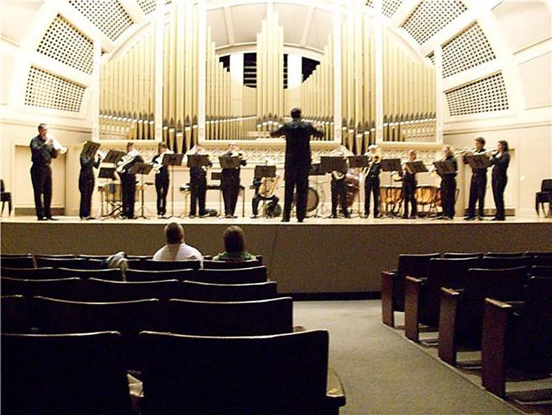EMU's Wind Symphony, directed by Dr. Mary Schneider, performed at Pease Auditorium on Friday. Composers played included Antonin Dvorak and Alfred Uhl.
