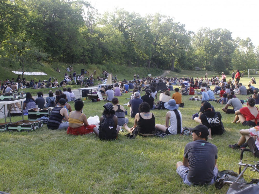 About 300 people gathered in Frog Island Park on Juneteenth to honor Black lives and discuss steps toward police abolition. Attendees listen as a panel of Black community members speak.