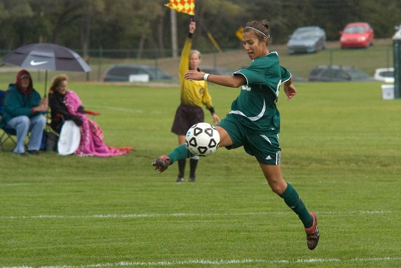 Ashley Rodrigues (99) kicks the ball Sunday to a fellow teammate in a chance for an Eastern Michigan goal.