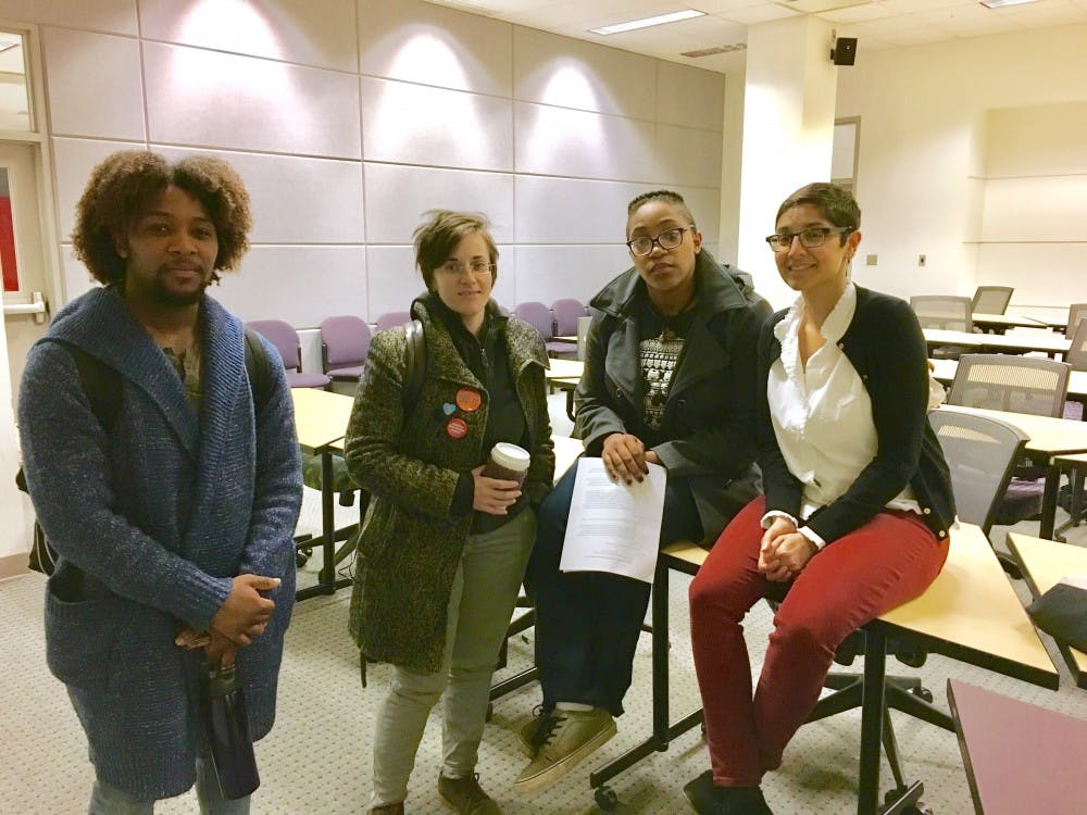 From left to right, Preston Johnson, junior majoring in Women's and Gender Studies, Dominique Williams, senior double majoring in Cultural Anthropology and International Studies, Myka Demeri, junior double majoring in African American Studies and German Language and Literature and Meena Krishnamurthy, Ph.D. assistant professor of Philosophy at University of Michigan.