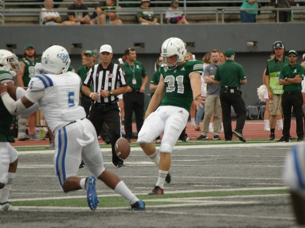 EMU punter Jake Julien kicks ball away at Rynearson Stadium on Sept. 21.