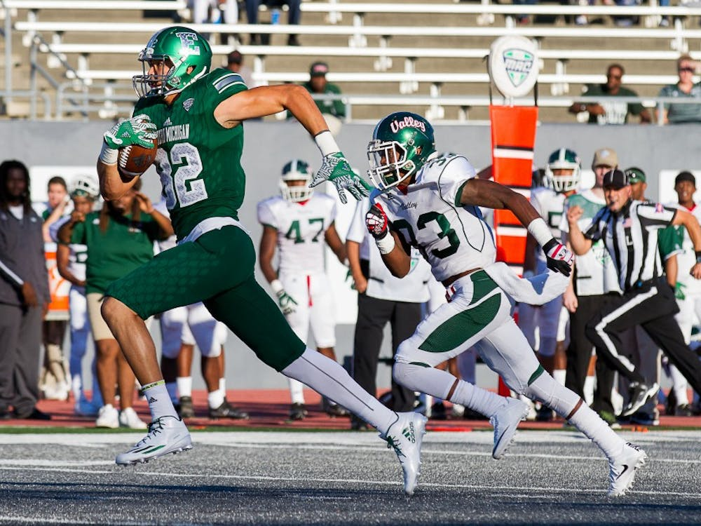 Eastern Michigan tight end runs past a defender during the Eagles' 61-14 win on Sept. 2.