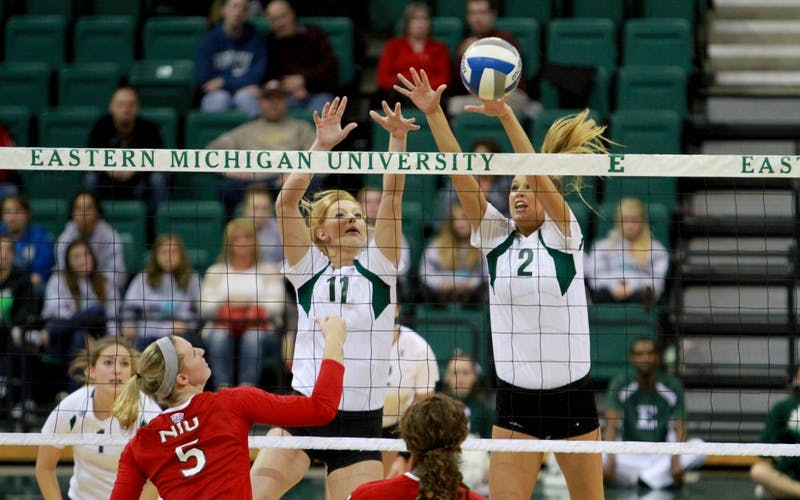 Katie Krasowski and Devon Murray block the ball against Northern Illinois on Oct. 30.