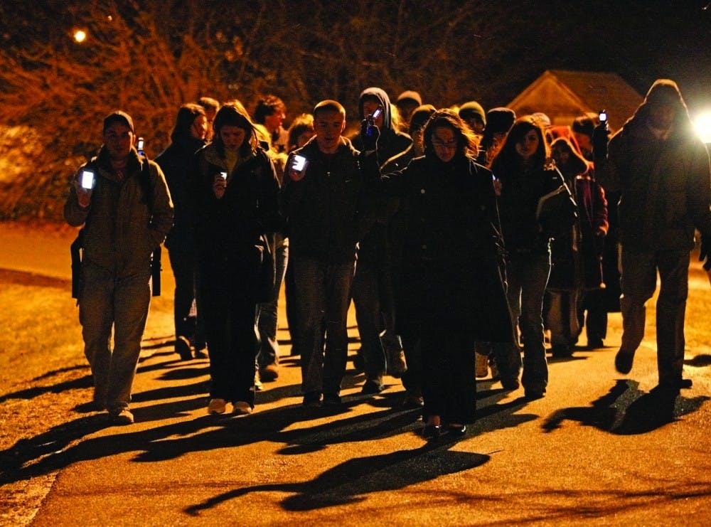 Students honor victims of Haiti crisis with vigil