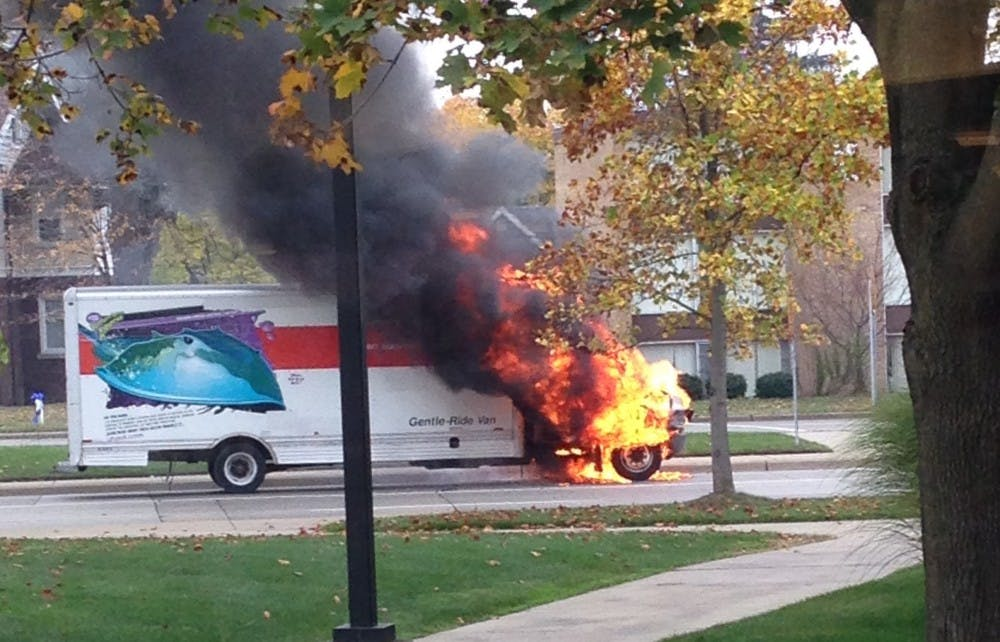 Truck catches fire in front of EMU campus