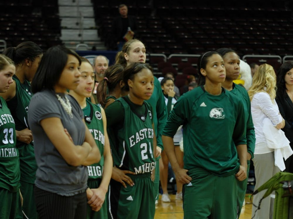 Tavelyn James, No. 24,  and the Eastern Michigan women's basketball team look on as BGSU celebrates its MAC Championship win Saturday in Cleveland.