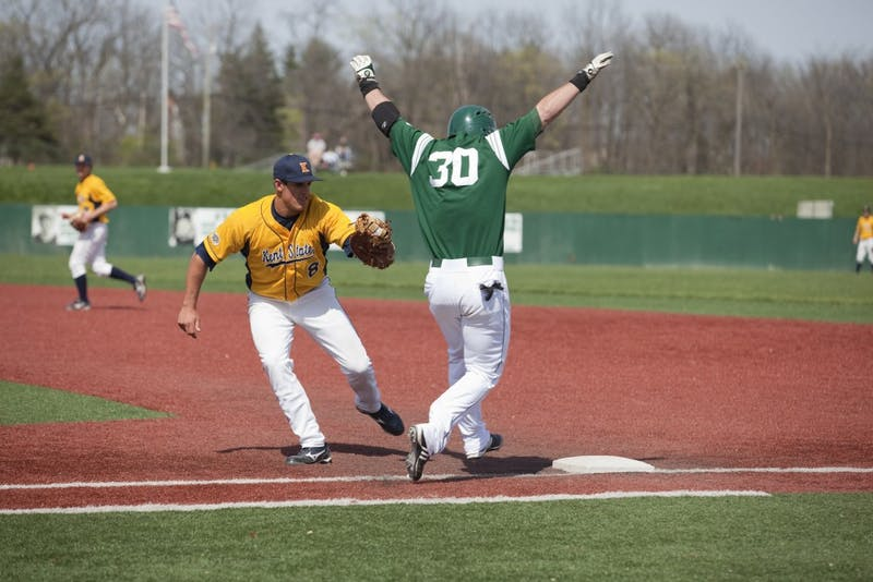 Andrew Marshall (30) is set to get tagged to complete a double play by Kent State in the sixth inning.