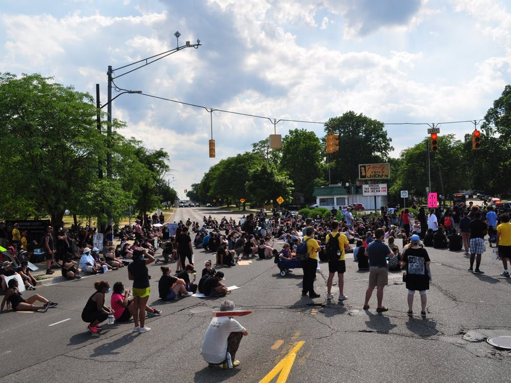 Black Lives Matter protestors gather at the intersection of Congress St. and W. Michigan Ave. on Saturday, June 20. Photo courtesy of Casey Field/Casey Field Photography.