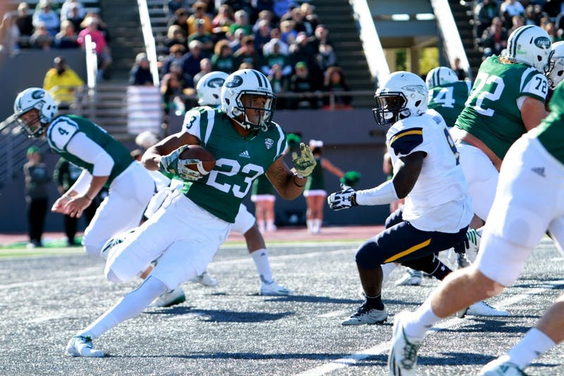 Kevin McGill runs against Toledo at Rynearson Stadium in Ypsilanti on Saturday, Oct. 8.