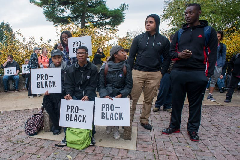 "Protesters holding ""pro-black"" signs at the rally outside of Ford Hall at Eastern Michigan University on Wednesday, Nov. 2 to protest racism and the racial graffiti incidents on campus over the past month."