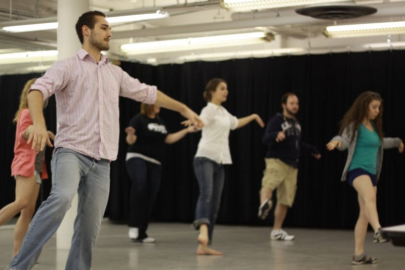"(Left) The cast of ""Little Me"" surrounds Andy Orscheln during rehearsals beneath Dining Commons 1. (Above)  Tyler Knauf practicing the choreography of the Neil Simon musical reimagined by professor Ken Stevens."