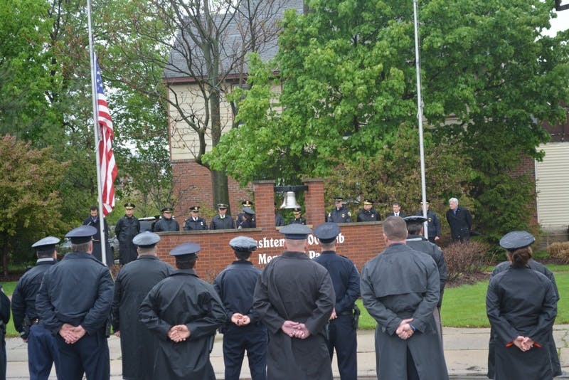 Washtenaw County police officers honoring those lost in the line of duty at Memorial Park.