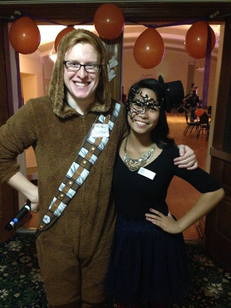 Spencer Mattinson, disc jockey at the event, dressed as Chewbacca with Adrienne Cruz, founder and president of Pencils of Promise at EMU, dressed as Mystery.