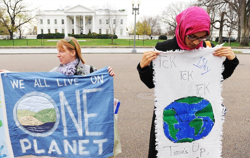 Environmental activists rally in front of the White House Dec. 4 to call on the Obama administration to step up its efforts on climate changge in Copenhagen and domestically, for a better financial situation.