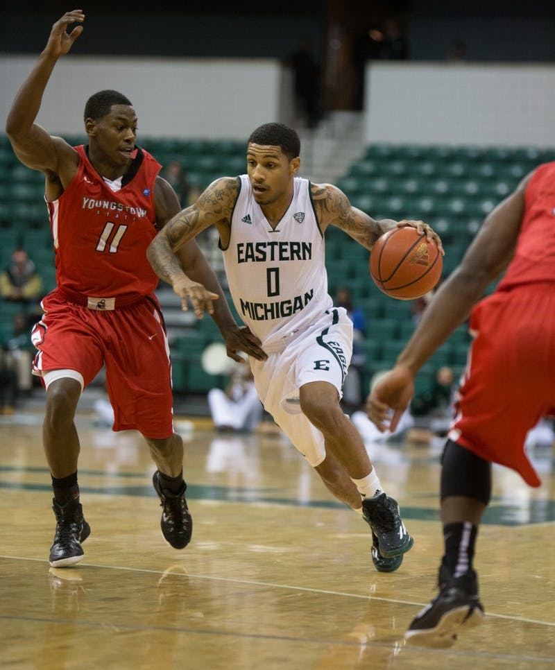 Eastern Michigan guard Ray Lee drives past the defender in the Eagles 71-62 win over Youngstown State Friday night in Ypsilanti.