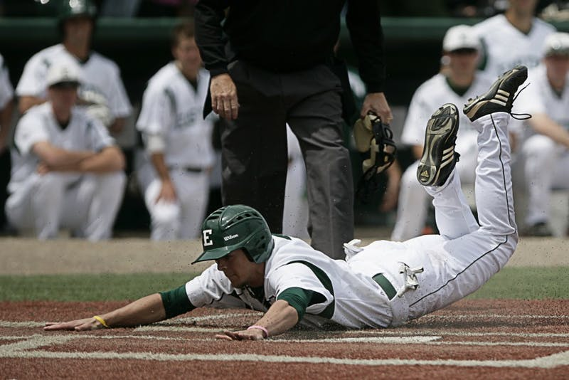 CF Bo Kinder (2), slides into homeplate head first to give the Eagles their first run of the game against Toledo on Sunday, May 16. The Rockets defeated Eastern Michigan 7-3.