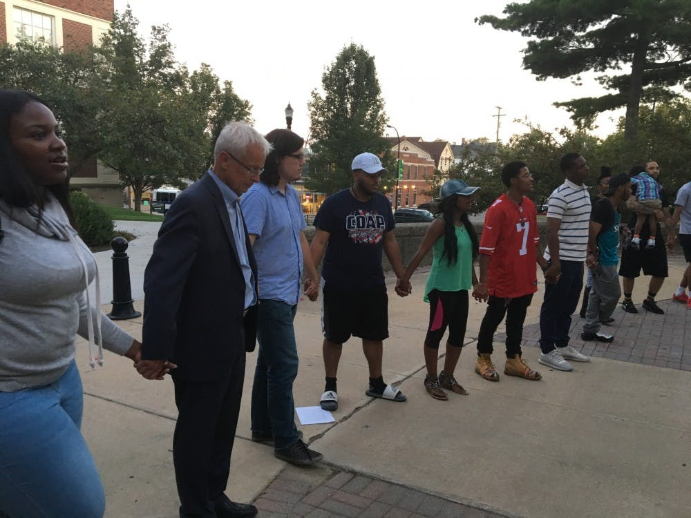 Eastern Michigan University's Black Student Union holds racial graffiti memorial rally