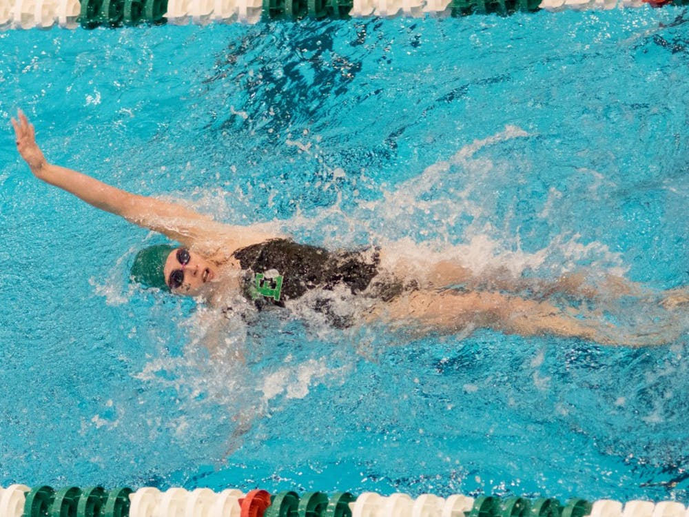 Alexis Mitcheltree backstrokes at the swimming meet at Jones Natatorium on Oct. 31.