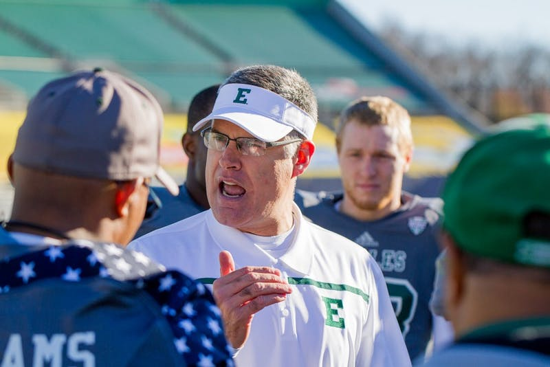 Head coach Chris Creighton speaks to the seniors before the Eagles' 28-17 loss to UMASS at Rynearson Stadium.