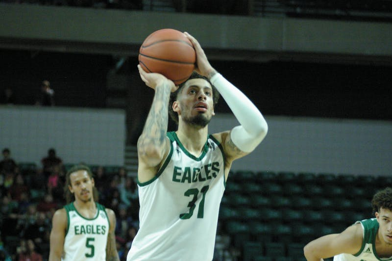 EMU forward Ty Groce shoots a free throw at the Convocation Center on Nov. 8.