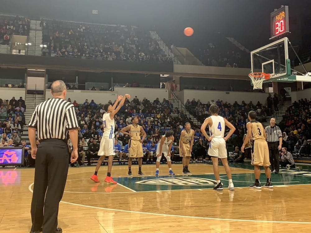 Emoni Bates (left) shoots a free-throw as Lincoln extends their lead over Ypsilanti at the Convocation Center.