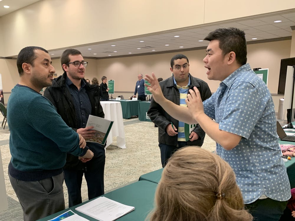 Eastern Michigan instructor speaks with prospective graduate students at the fall 2019 Graduate Open House.