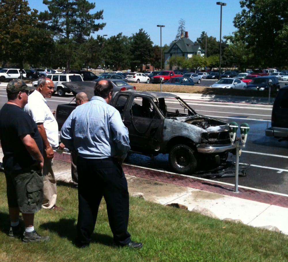 Parked vehicle near Pierce Hall destroyed by fire