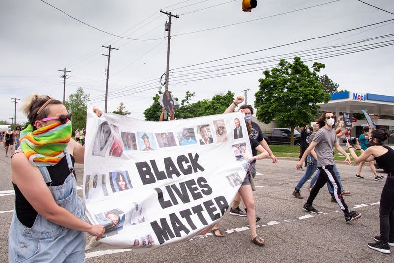 Protesters block the intersection of Hogback Rd., Capenter Rd. and Washtenaw Ave. (continued)
