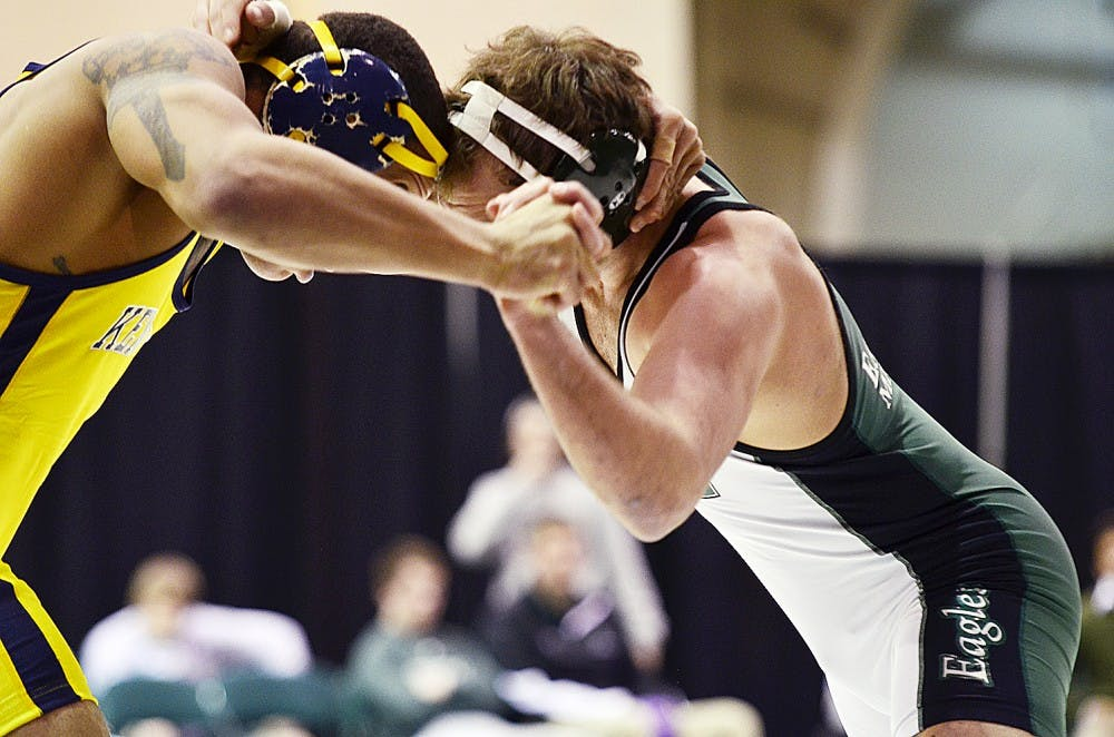 EMU wrestling places eighth at MAC tournament