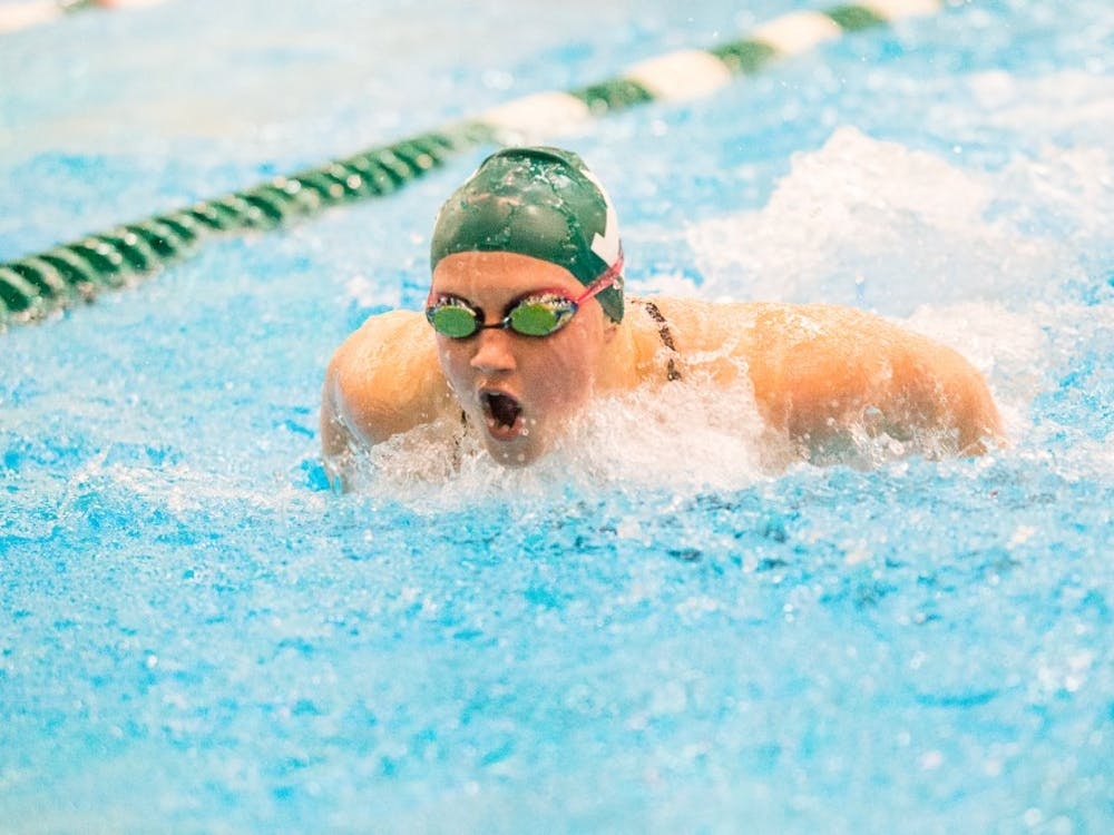 EMU swimmer competes in the butterfly against Cincinnati on Nov. 15 in Ypsilanti.