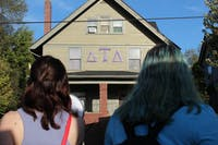 Eastern Michigan University students protest outside Delta Tau Delta on Oct. 19.