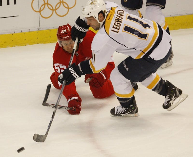 The Detroit Red Wings' Niklas Kronwall fights for the puck with the Nashville Predators' David Legwand (11) during first-period action in Game 4 of the Western Conference Quarterfinals on Tuesday, April 17, 2012, at Joe Louis Arena in Detroit, Michigan. (Kirthmon F. Dozier/Detroit Free Press/MCT)