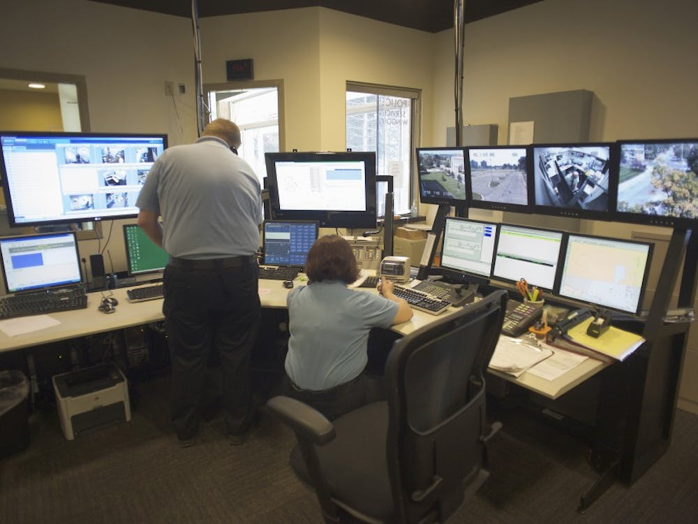 Members of EMU's Department of Public Safety work at the dispatch center in their new headquarters.