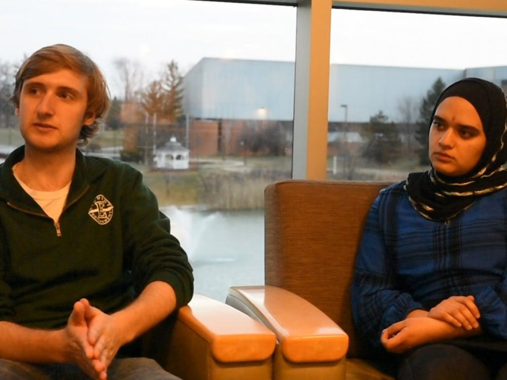 President-elect Ethan Smith and Vice-President-elect Hajer Abuzir discuss privatized housing and food insecurity at Eastern Michigan University