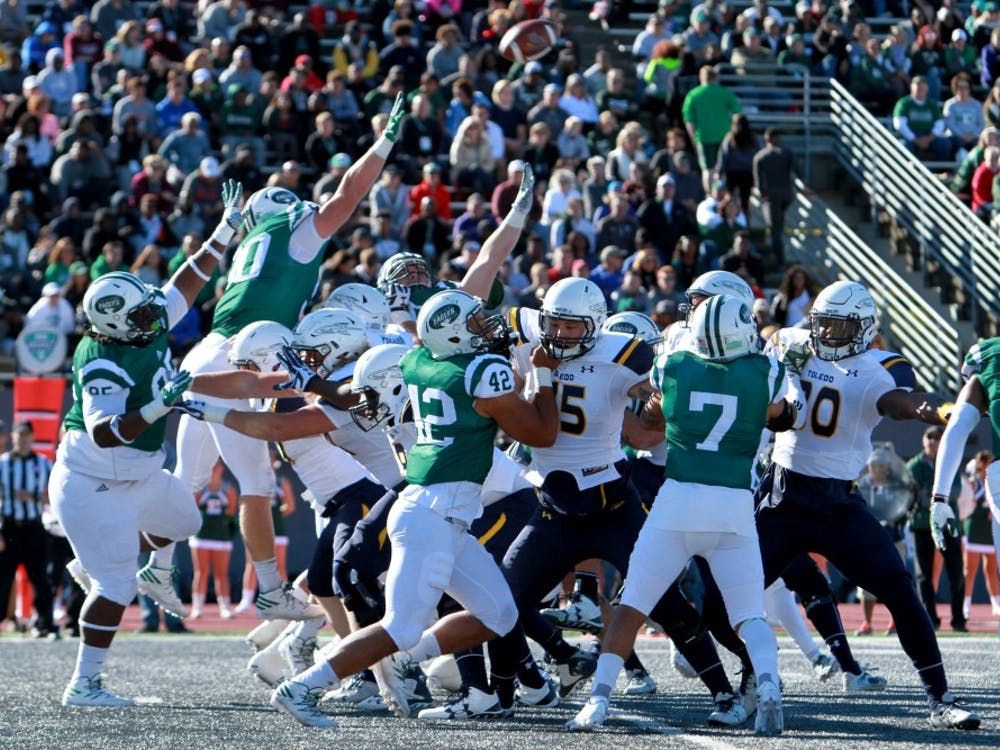 The team tries to block the kick during the football game against Toledo at Rynearson Stadium in Ypsilanti on Saturday, October 8, 2016.