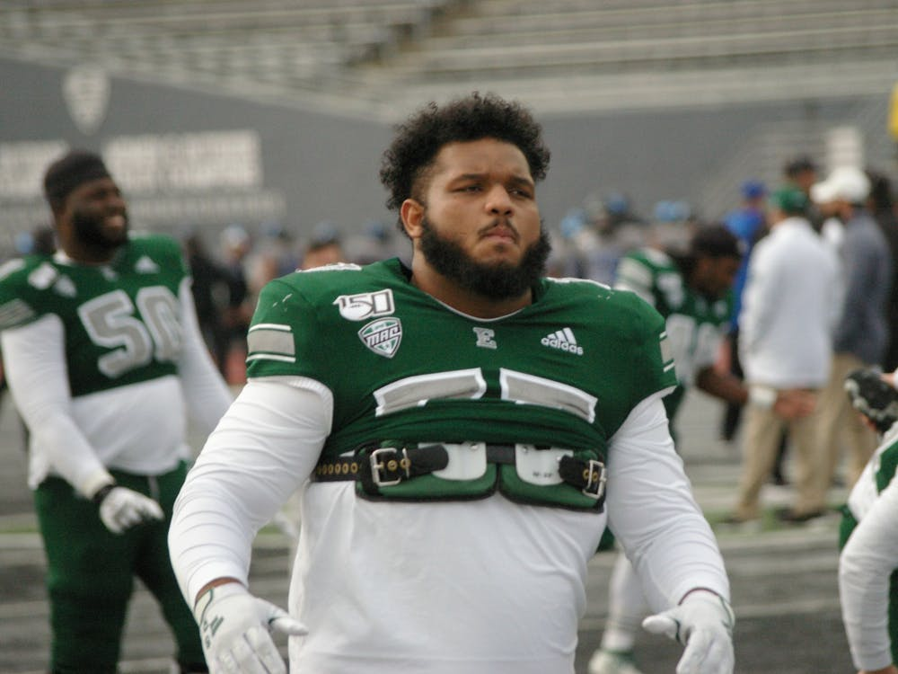 Eastern Michigan nose tackle Ty Eddington returns from injury and warms up with team at Rynearson Stadium Nov. 2.