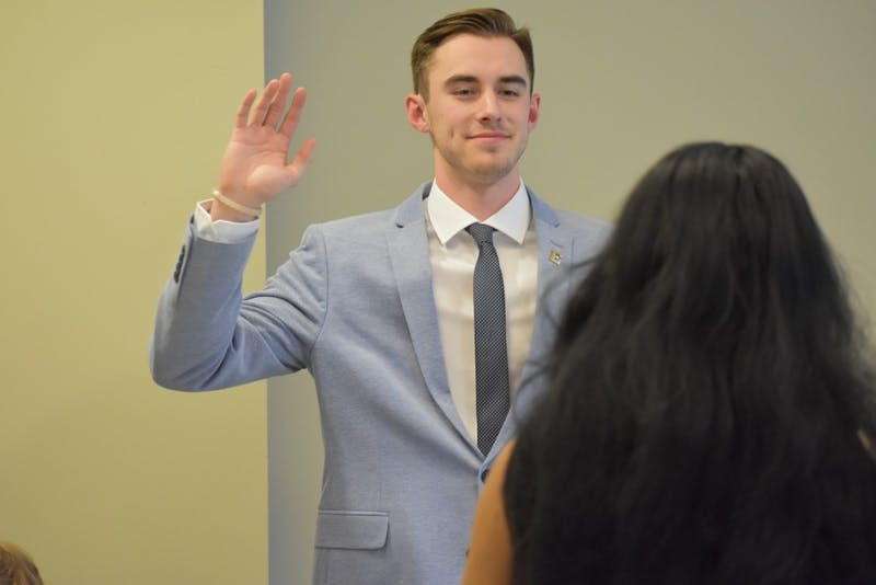 Taylor Lawrence is sworn in for his second term as Speaker of the Senate by Student Body President Candice Crutcher at the Senate's organizational meeting on Tuesday, April 9th.