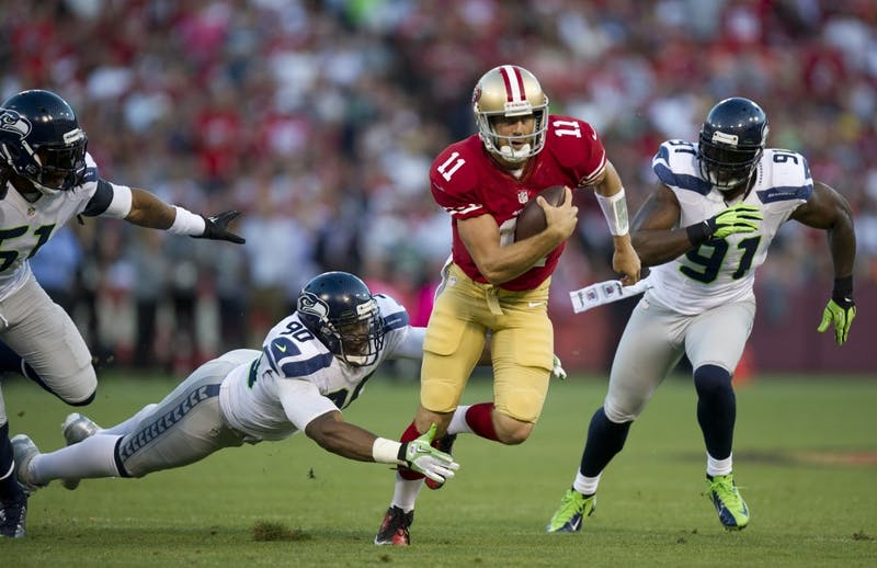 San Francisco 49ers quarterback Alex Smith (11) scrambles under pressure from Seattle Seahawks defensive ends Jason Jones (90) and Chris Clemons (91) at Candlestick Park in San Francisco, California, on Thursday, October 18, 2012. (Paul Kitagaki Jr./Sacramento Bee/MCT)