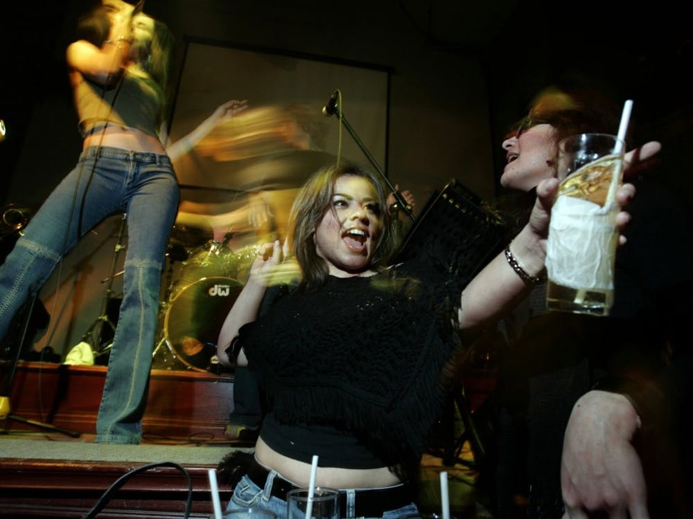 -- NO MAGS, NO SALES -- KRT US NEWS STORY SLUGGED: MEXICO-BORDERDRINKING KRT PHOTOGRAPH BY ERICH SCHLEGEL/DALLAS MORNING NEWS (February 7) Brownsville college students Rebecca Martinez, left, and Veronica Cano dance to the sounds of the Monterrey rock band Los Ultimos at Club Jaa's in Matamoros, Mexico, on a recent Friday night. (cdm) 2005 (Diversity)
