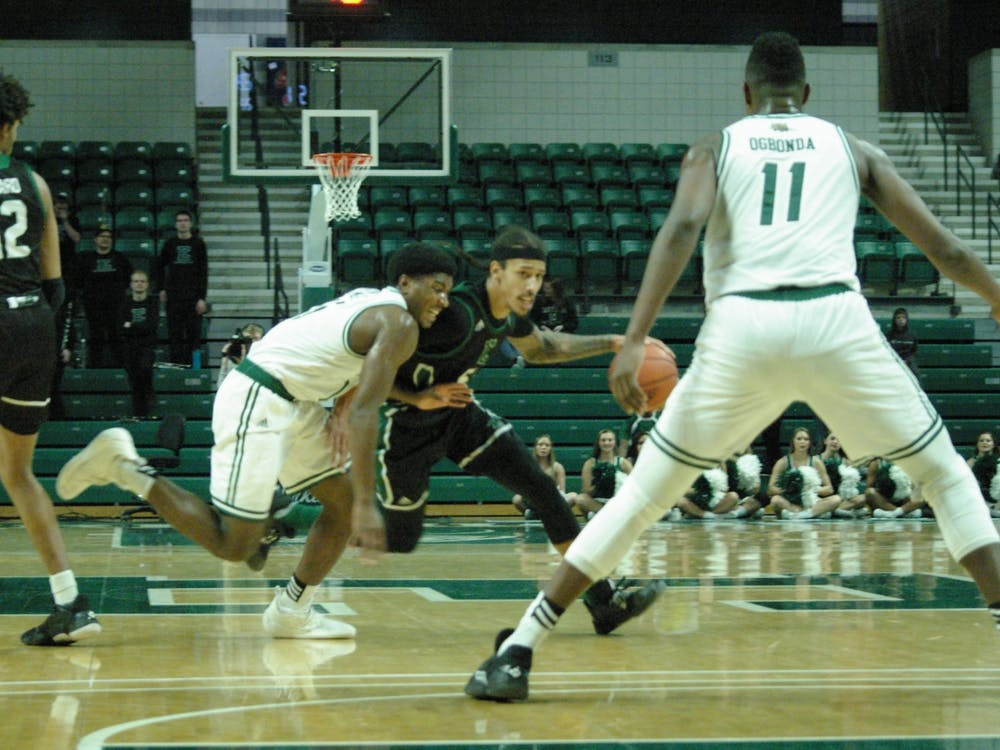 Noah Morgan makes a move to the basket at the Convocation Center on Jan. 18.