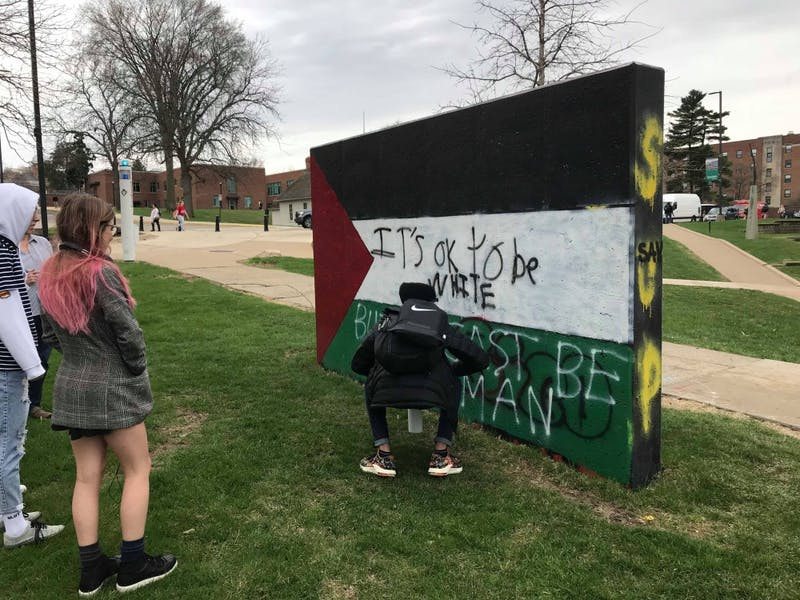 Students Paint Responses to the Controversial Phrase Written on the Freedom Walls