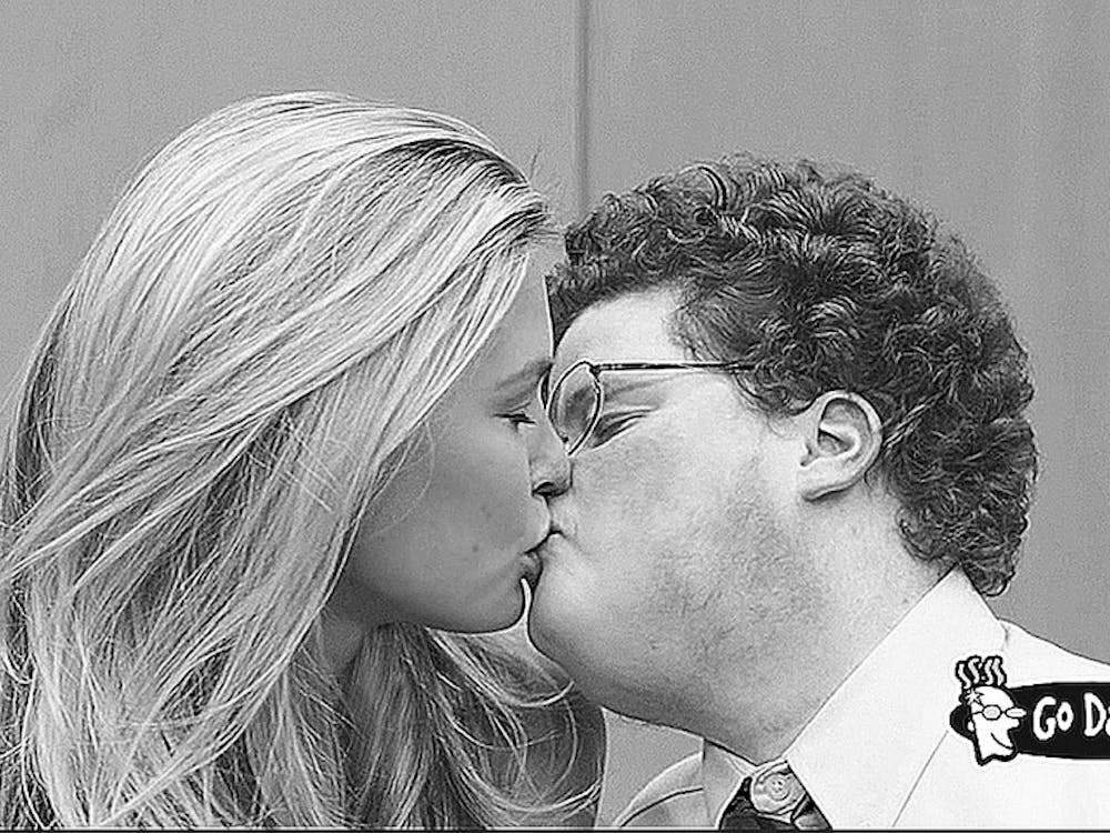 """Go Daddy will air its """"Perfect Match"""" during the Super Bowl, featuring supermodel Bar Refaeli and character actor Jesse Heiman, right. The pair's smooch required 45 takes, after which Heiman said he felt like he """"had just won ... the Championship of Men."""" (MCT)"""
